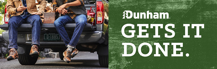 Men wearing Dunham boots on the back of a pick-up truck